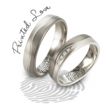 OE wedding ring with fingerprinted engraving.jpg